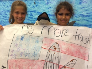 """Poster with USA flag, breaching whale and """"no more trash"""""""