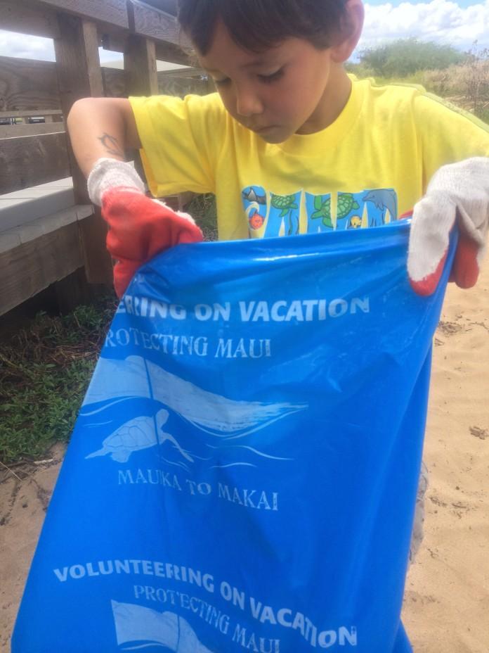 camper with bag for debris