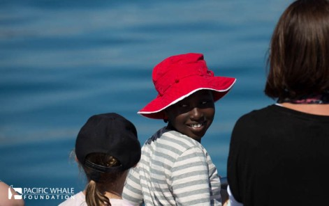 Child enjoying a day of whale watching.