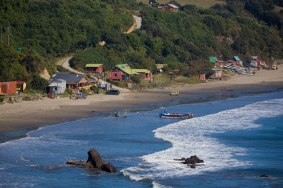 Puñihuil is a cove with a small fishing community that has steadily grown in tourism with penguin excursions where Magellan and the rare Humboldt penguins can be seen off the coast.