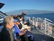 Greg Kaufman hosting whale watch trip with guests Muhammad Ali and Kris Kristofferson